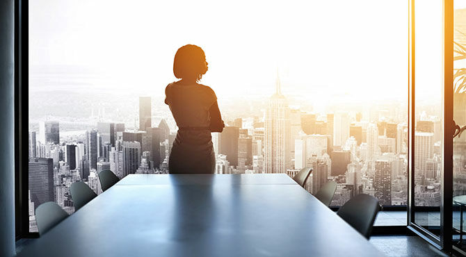 Woman in office overlooking city