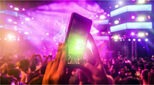 Image of concert goer holding up smartphone