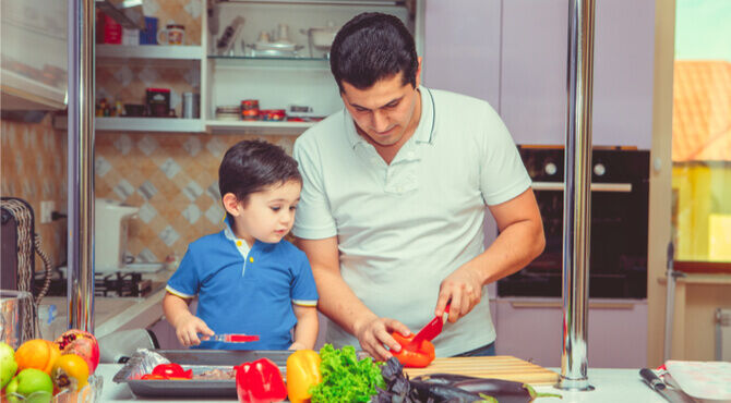 Father and son preparing food