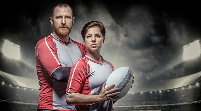 Man and woman with rugby bal
