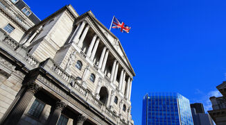 Bank of England with UK flag and cityscape