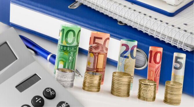 Image of calculator and stacks of Euro currency
