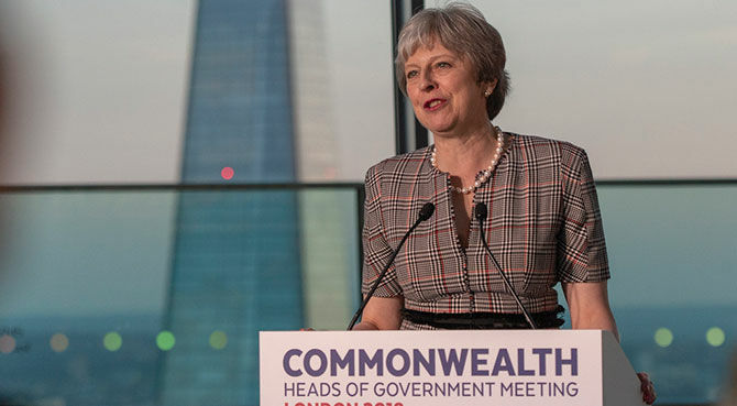Theresa May speaking at CHOGM