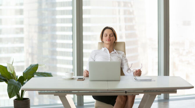 Image of woman at desk