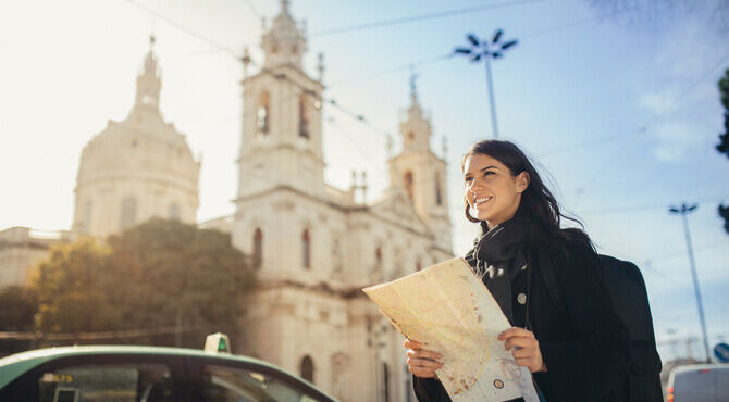 Image of woman with a map in Portugal