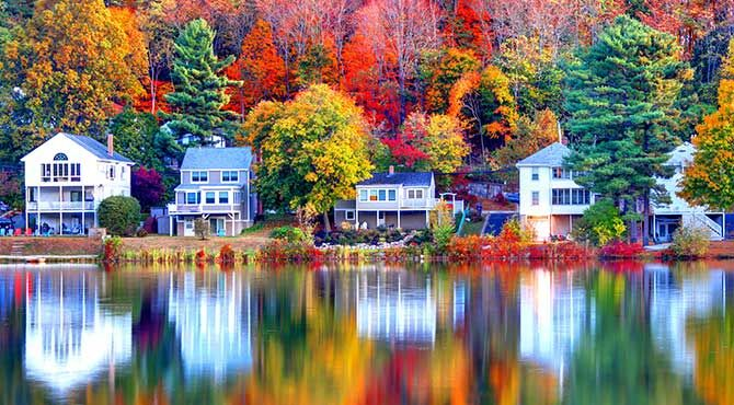 Homes outside of Boston USA in autumn after the leaves have begun to turn colour