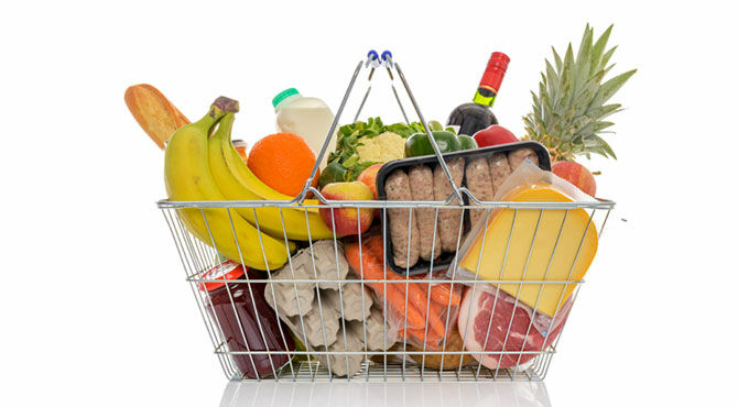 A supermarket basket full of groceries used to illustrate an article about new perks from Select Apartments