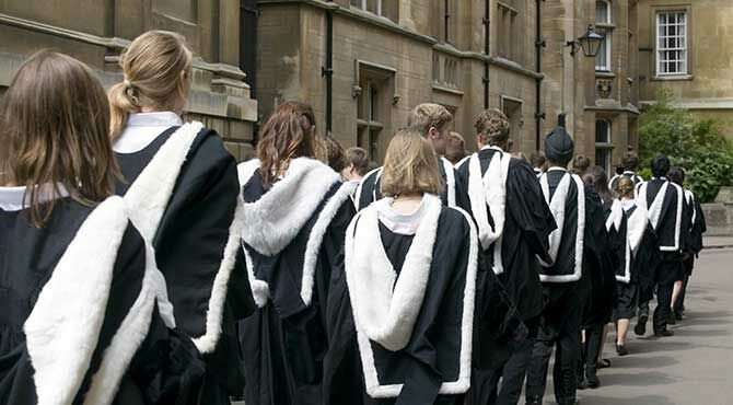 Graduands from Clare College Cambridge process to their graduation ceremony