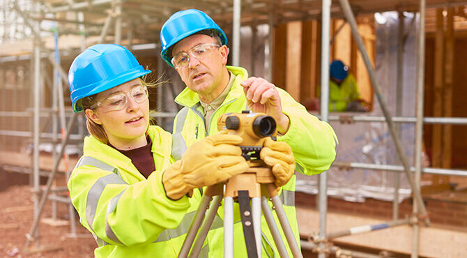 Construction apprentice with tutor