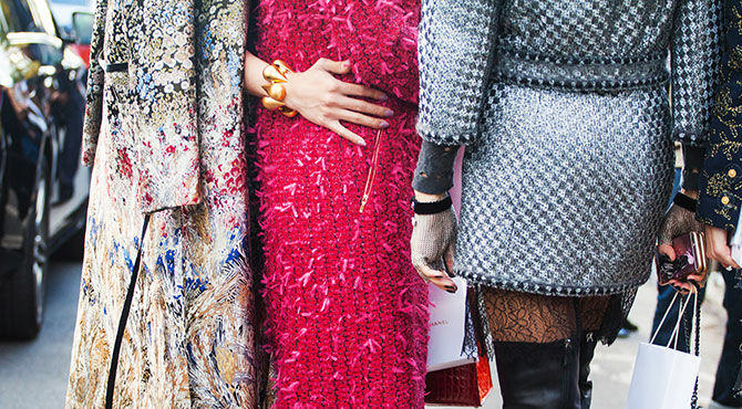 Image of two women wearing stylish outfits to illustrate an article about the fashion industry
