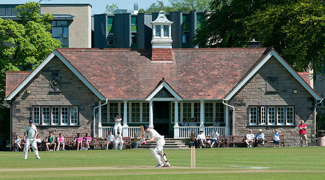 Scottish independent school students playing cricket