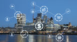 Fintech symbols superimposed over the London skyline