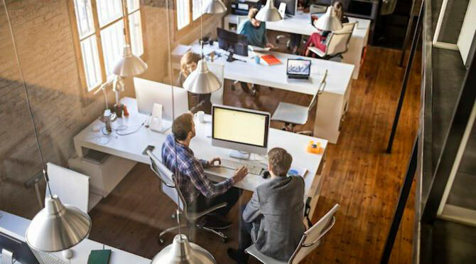 Small businesses need £13m a year to boost productivity: CIPD - image of people in an open plan office
