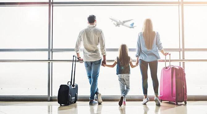 Relocating family at airport Chamness Worldwide