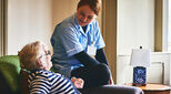 NHS careworker looking after elderly woman