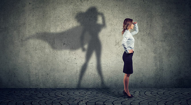 An image of a businesswoman with her shadow showing that she is Superwoman