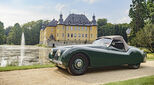 Jaguar in front of a stately home