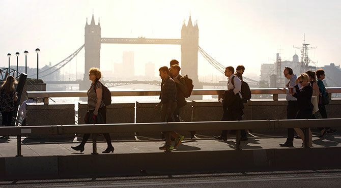 Workers and other Londoners walking over London Bridge