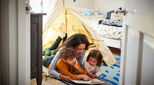 Mum and kids with indoor tent
