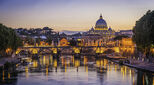 Rome sunset over Tiber and St Peters Basilica