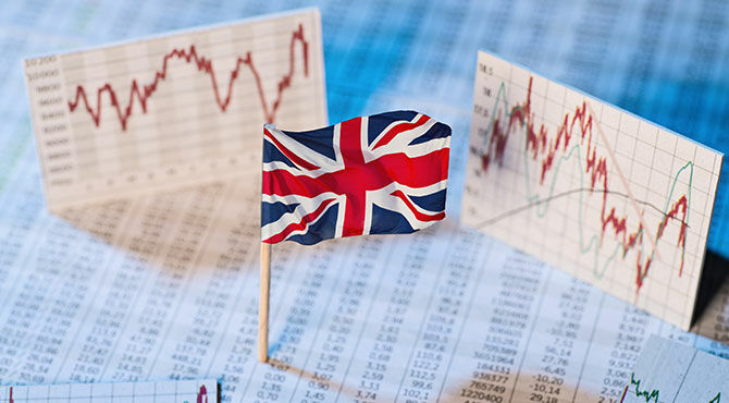 Union Jack flag with financial charts