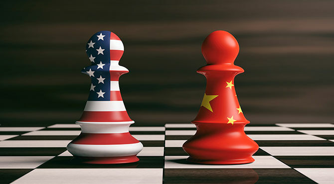 Chessboard with two US and Chinese flag chess pieces