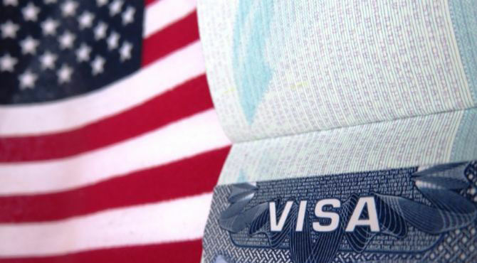 US flag with passport and word visa