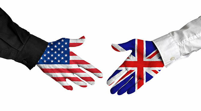 Two hands, with US and UK flag superimposed, shake hands
